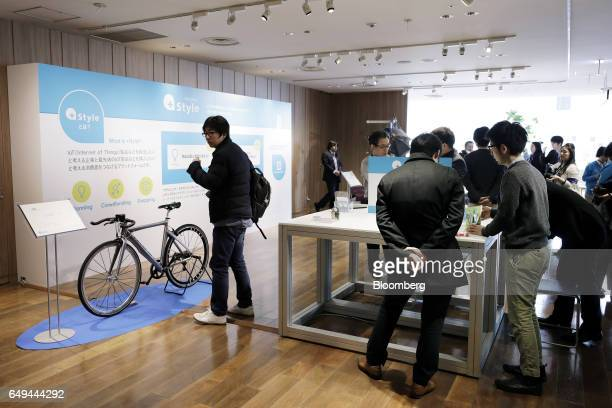 Attendees look at various products displayed at a SoftBank Corp Style media event in Tokyo Japan on Wednesday March 8 2017 Part of SoftBank's push...