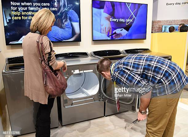 Attendees look at Whirlpool's new Smart Top Load washer and dryer at the 2015 International CES at the Sands Expo and Convention Center on January 6...