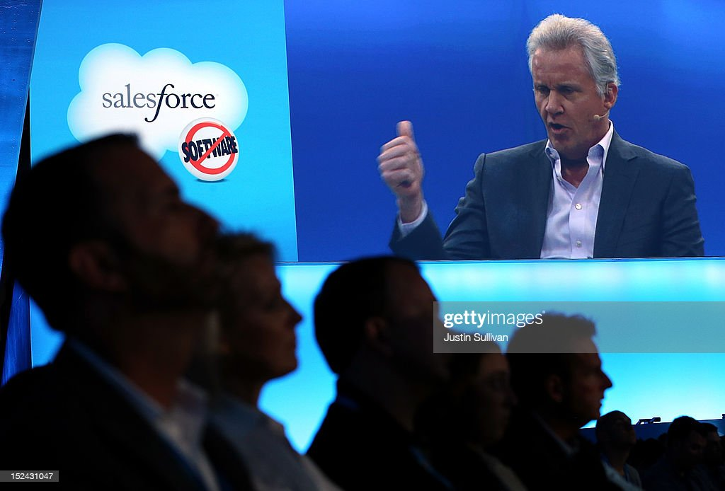 Attendees look on as General Electric CEO Jeff Immelt is seen on a video screen as he speaks during the Dreamforce 2012 conference at the Moscone Center on September 20, 2012 in San Francisco, California. A reported 90,000 people registered to attend the cloud computing industry conference Dreamforce 2012 that runs through September 21.