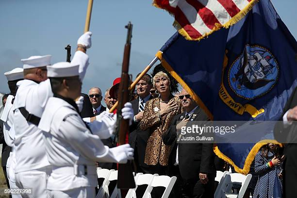 Attendees look on as the an honor guard presents the colors during a ship naming ceremony for the new USNS Harvey Milk on August 16 2016 in San...
