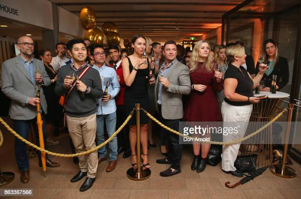 Attendees look on at Sydney Opera House on October 20 2017 in Sydney Australia More than 800 people gathered to celebrate global champagne day and...