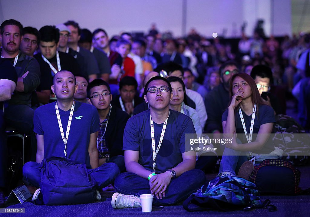 Attendees look on during the opening keynote at the Google I/O developers conference at the Moscone Center on May 15, 2013 in San Francisco, California. Thousands are expected to attend the 2013 Google I/O developers conference that runs through May 17.
