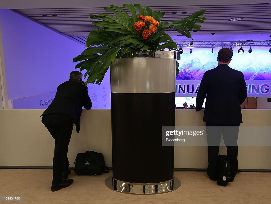 Attendees look out over the main hall on the opening day of the World Economic Forum (WEF) in Davos, Switzerland, on Wednesday, Jan. 23, 2013. World leaders, Influential executives, bankers and policy makers attend the 43rd annual meeting of the World Economic Forum in Davos, the five day event runs from Jan. 23-27. Photographer: Chris Ratcliffe/Bloomberg via Getty Images
