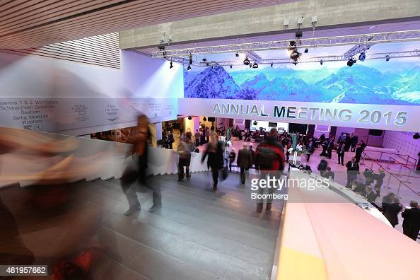 Attendees move between session halls on day two of the World Economic Forum in Davos Switzerland on Thursday Jan 22 2015 World leaders influential...