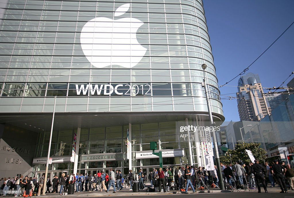 Attendees of Apple's developer conference, WWDC 2012, wait outside of the Moscone Center in San Francisco, California to attend Apple's Keynote on June 11, 2012. The Apple WWDC 2012 takes place in San Francisco between June 11 and 15. AFP Photo/ Kimihiro HOSHINO