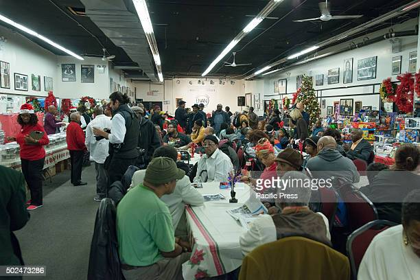 Attendees of the NAN holiday meal fill the House of Justice New York City Mayor Bill de Blasio and his daughter Chiara joined Reverend Al Sharpton at...