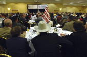 Attendees of the state republican convention at the Marriott hotel in Albuquerque NM listen to a candidate's speech