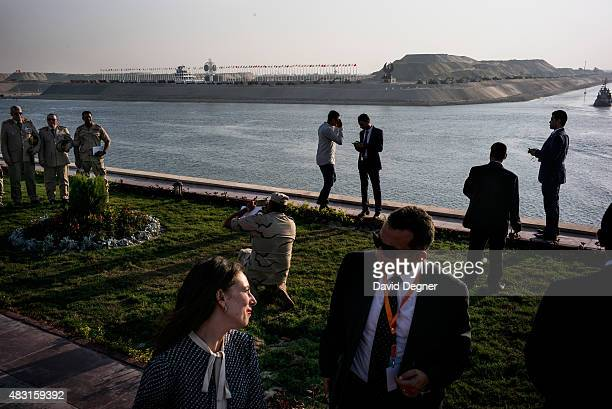 Attendees organizers and participents take photos and relax beside the new canal after the opening ceremony of the new Suez Canal expansion including...