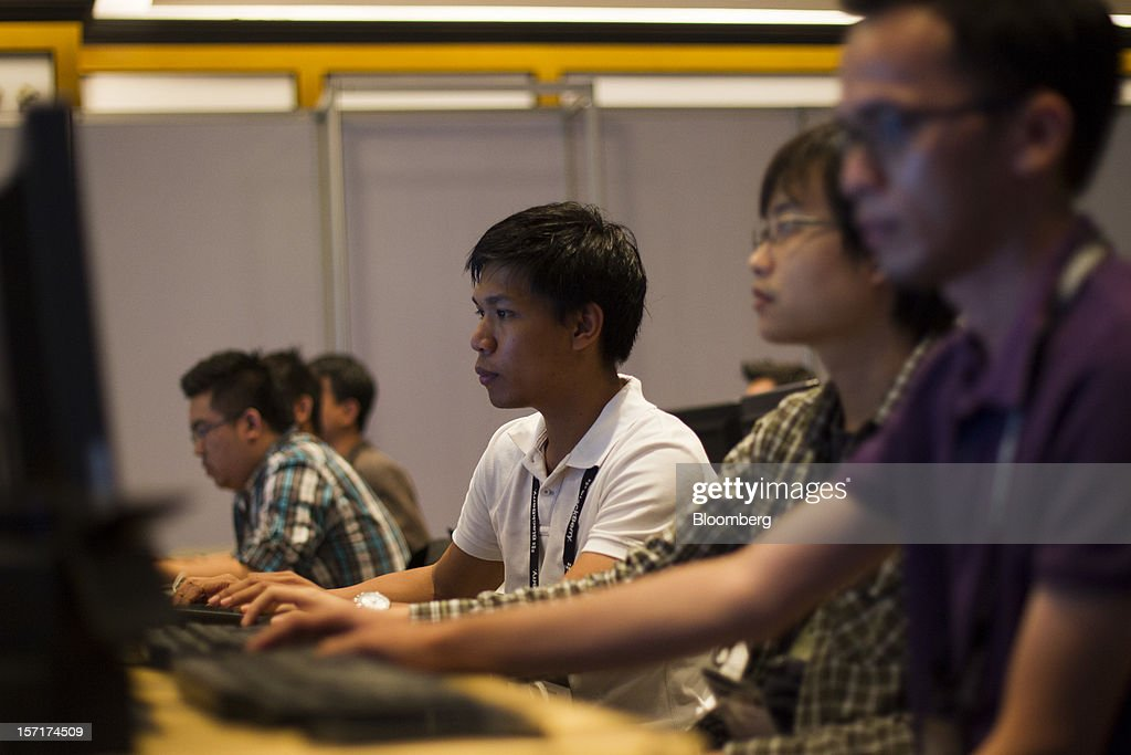 Attendees participate in a workshop at the Research In Motion Ltd. (RIM) BlackBerry Jam Asia developer conference in Bangkok, Thailand, on Thursday, Nov. 29, 2012. RIM gained after Goldman Sachs Group Inc. upgraded the stock to buy, saying the new BlackBerry 10 phones could help it return to profitability in fiscal 2014. Photographer: Brent Lewin/Bloomberg via Getty Images