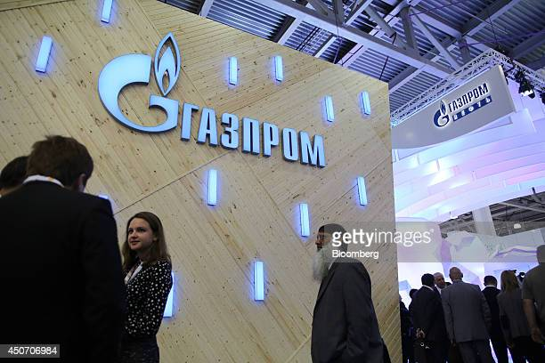 Attendees pass the OAO Gazprom corporate pavilion during the 21st World Petroleum Congress in Moscow Russia on Monday June 16 2014 Work between...
