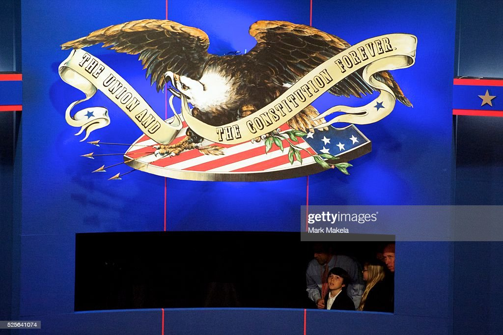 Attendees peer onto the stage setting from the back wall of the set for the Vice Presidential Debate with Joe Biden and Paul Ryan a few hours before...