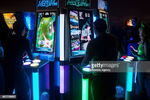 Attendees play a music themed arcade game at MAGfest 13 in National Harbor Md on January 24 2015 MAGfest is an annual convention held in the...