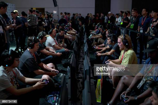 Attendees play the 'LawBreakers' video game by Nexon Co during the E3 Electronic Entertainment Expo in Los Angeles California US on Tuesday June 13...