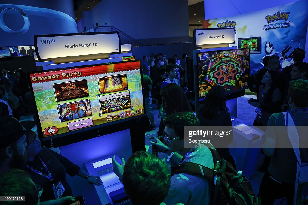 Attendees play the Mario Party 10 video game on a Nintendo Co. Wii U console during the E3 Electronic Entertainment Expo in Los Angeles, California, U.S., on Wednesday, June 11, 2014. E3, a trade show for computer and video games, draws professionals to experience the future of interactive entertainment as well as to see new technologies and never-before-seen products. Photographer: Patrick T. Fallon/Bloomberg via Getty Images