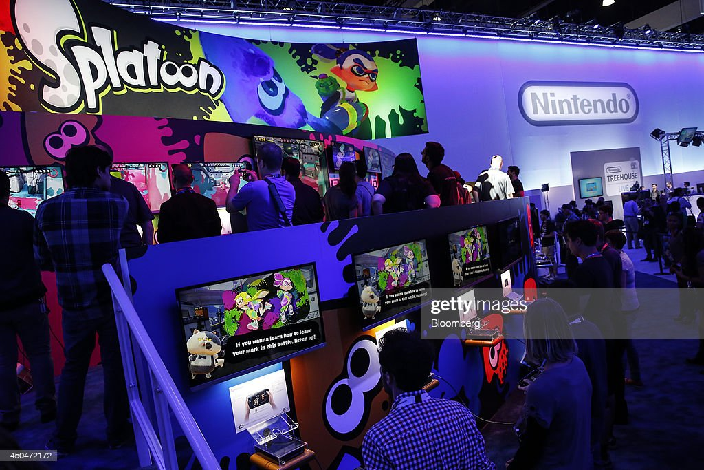 Attendees play the Nintendo Co. video game Splatoon during the E3 Electronic Entertainment Expo in Los Angeles, California, U.S., on Wednesday, June 11, 2014. E3, a trade show for computer and video games, draws professionals to experience the future of interactive entertainment as well as to see new technologies and never-before-seen products. Photographer: Patrick T. Fallon/Bloomberg via Getty Images