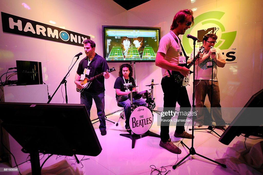Attendees play the video game for Microsoft XBox 360 'The Beatles:Rock Band' in the MTV games booth during the Electronics and Entertainment Expo (E3) on June 3, 2009 in Los Angeles, California. The 2009 E3 Expo will feature over 200 leading-edge computer, technology and video game publishers and developers, according to organizers. The industry-only trade show runs June 2-4 at the Los Angeles Convention Center (LACC).