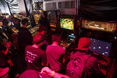 Attendees play video games in the Doritos #MixArcade fan experience during the E3 Electronic Entertainment Expo in Los Angeles California US on...
