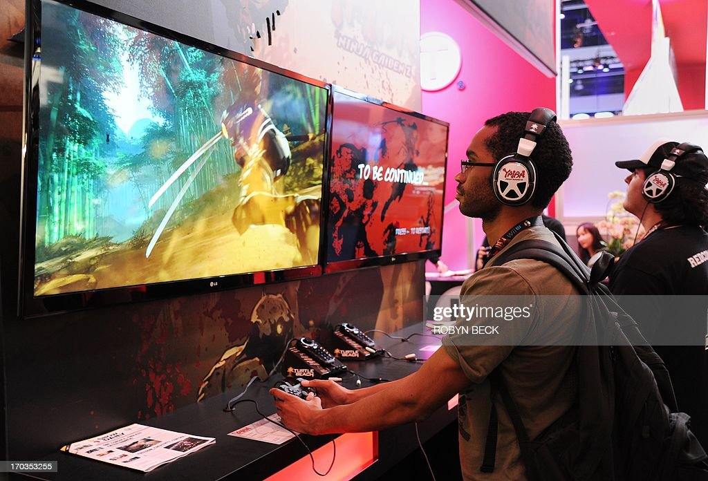 Attendees play 'Yaiba: Ninja Gaiden Z' on the first day of the Electronic Entertainment Expo (E3) in Los Angeles on June 11, 2013. The Electronic Entertainment Expo (E3), an annual trade fair for the computer and video games industry, runs from June 11-13.