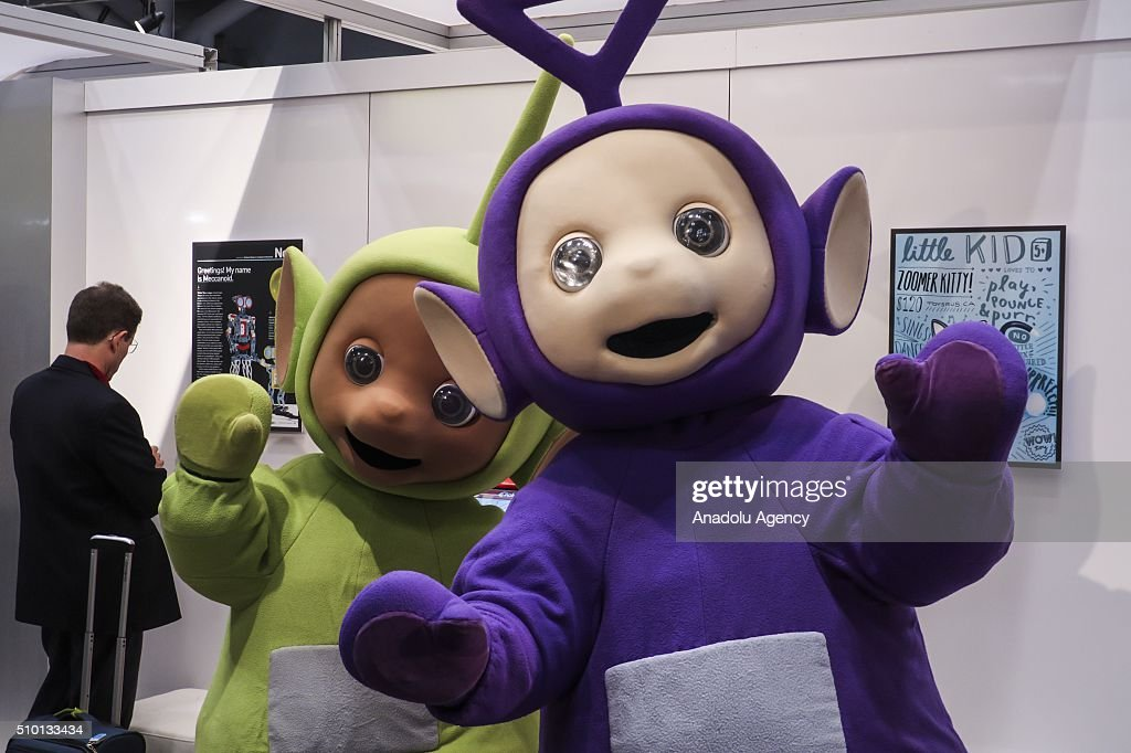 Attendees pose at New York's Javits Center on February 13, 2016, during the 113rd Annual American International Toy Fair New York 2016 starting on February 13 and ending on February 16. More than 200 companies from 100 countries have opened stands in the fair.