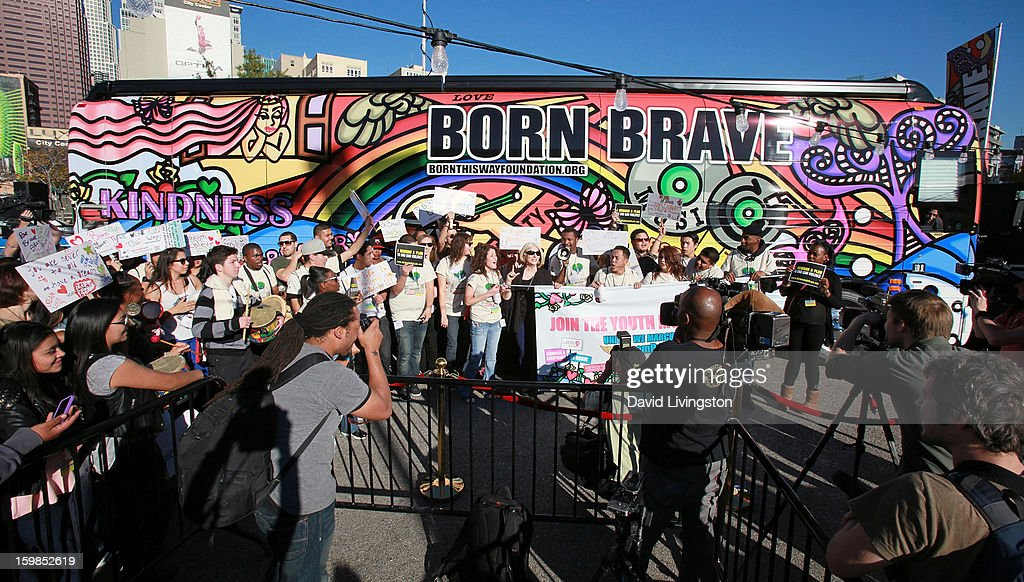 Attendees pose at the Born This Way Foundation's 'Born Brave Bus' Pre-show Tailgate Party at STAPLES Center on January 21, 2013 in Los Angeles, California.