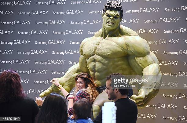 Attendees pose with a model of The Hulk at the Samsung booth at the Consumer Electronics Show January 8 in Las Vegas Nevada AFP PHOTO / Robyn BECK