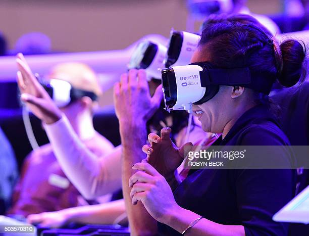 Attendees react to a demonstration of the Samsung Gear VR virtual reality headset at the Las Vegas Convention Center January 5 2016 in Las Vegas...