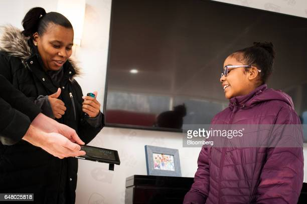 Attendees receive a Nintendo Co Switch game console to test during the company's launch event in New York US on Friday March 3 2017 Nintendo shares...
