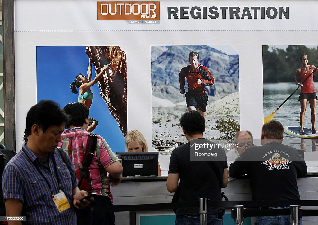 Attendees register during the Outdoor Retailer Summer Market show in Salt Lake City, Utah, U.S., on Thursday, Aug. 1, 2013. Consumer spending in the U.S. rose in line with forecasts in June as Americans' incomes grew, a sign the biggest part of the economy is withstanding fiscal headwinds. Photographer: George Frey/Bloomberg via Getty Images