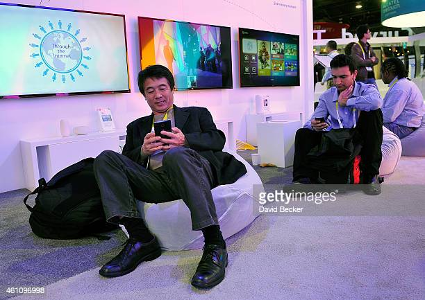 Attendees relax in beanbag chairs at the TCL booth during the 2015 International CES at the Las Vegas Convention Center on January 6 2015 in Las...