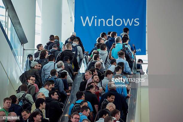 Attendees ride an escalator at the Moscone Center prior to start of the Microsoft Corp Developers Build Conference in San Francisco California US on...