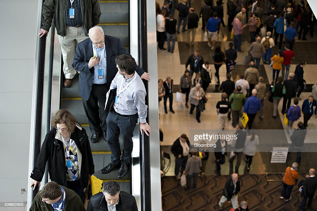 Attendees ride an escalator during a break at the Berkshire Hathaway Inc. annual shareholders meeting in Omaha, Nebraska, U.S., on Saturday, April 30, 2016. Dozens of Berkshire Hathaway Inc. subsidiaries will be showing off their products as Chief Executive Officer Warren Buffett hosts the company's annual meeting. Photographer: Daniel Acker/Bloomberg via Getty Images