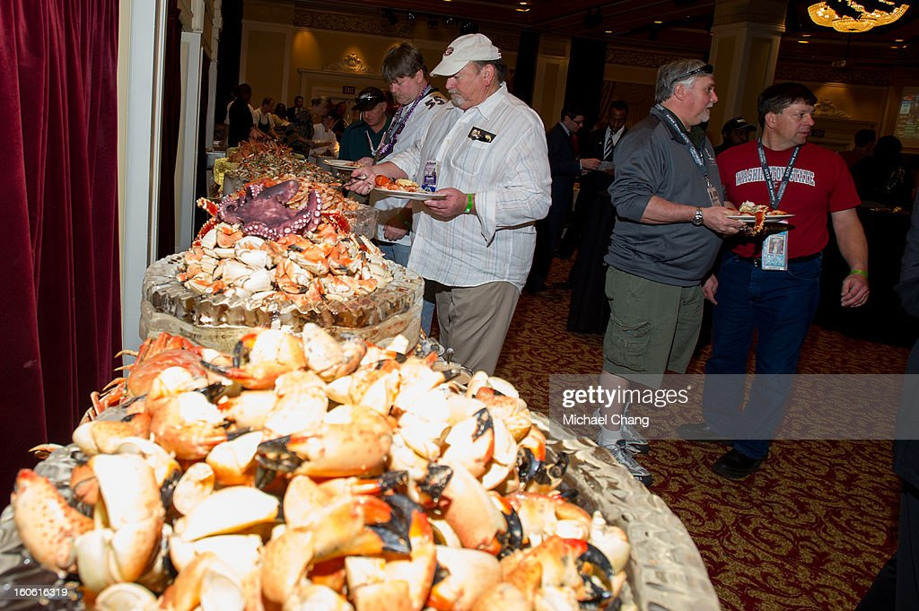 Attendees serve themselves from an assortment of seafood items during the Ultimate Super Bowl Tailgate Party hosted by Michael Strahan at Harrah's Casino on February 3, 2013 in New Orleans, Louisiana.