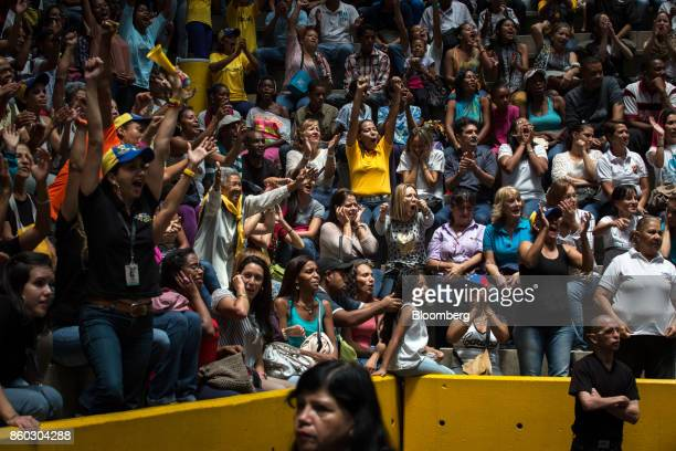 Attendees shout slogans while Henrique Capriles opposition leader and governor of the State of Miranda not pictured speaks during an event marking...