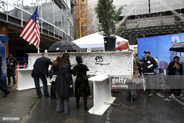 Attendees sign the final steel beam during a topping off ceremony for the Salesforce Tower in San Francisco California US on Thursday April 6 2017...