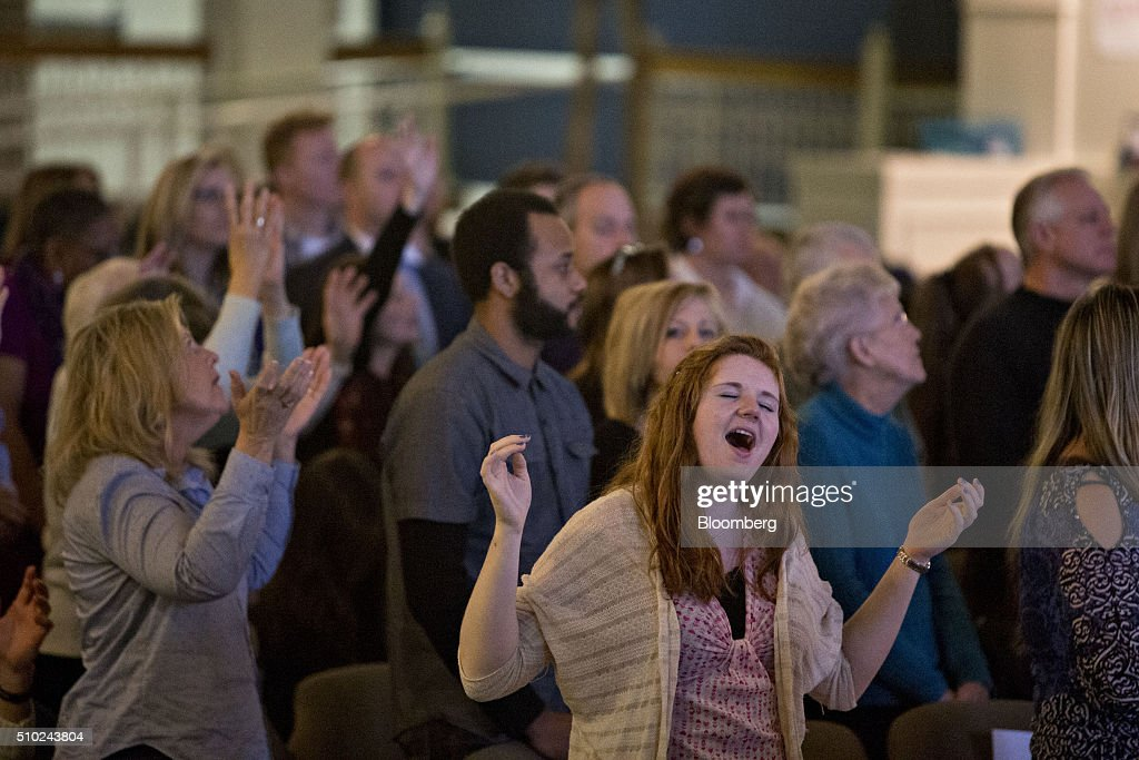 Attendees sing during a church service at Morning Star Ministries ahead of a speech by Ben Carson, retired neurosurgeon and 2016 Republican presidential candidate, not pictured, in Fort Mill, South Carolina, U.S., on Sunday, Feb. 14, 2016. Carson, responding to a question on MSNBC about the upcoming primary, said he continues to reassess the future of his campaign every day and that South Carolina will be a 'turning point.' Photographer: Daniel Acker/Bloomberg via Getty Images