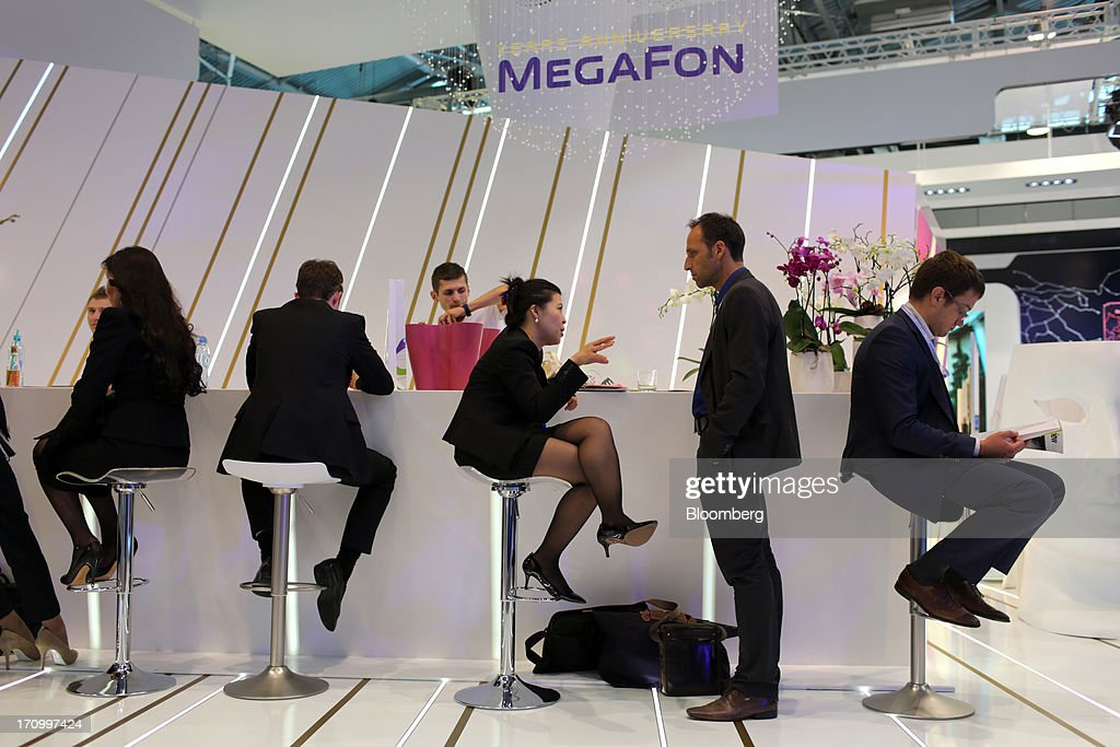 Attendees sit at the OAO MegaFon pavilion on the opening day of the St. Petersburg International Economic Forum 2013 (SPIEF) in St. Petersburg, Russia, on Thursday, June 20, 2013. Russian consumer spending probably eased and investment shrank at the fastest pace since 2011, adding to evidence the $2 trillion economy is stalling. Photographer: Andrey Rudakov/Bloomberg via Getty Images