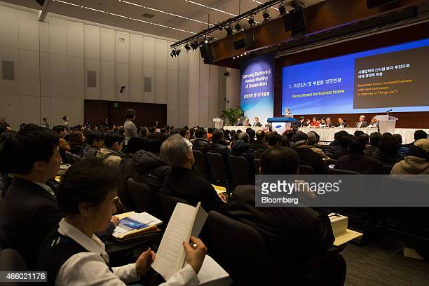 Attendees sit during the Samsung Electronics Co annual shareholders meeting at the company's Seocho office building in Seoul South Korea on Friday...
