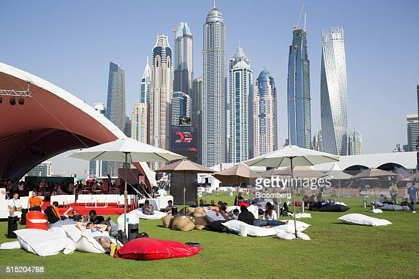 Attendees sit on bean bags as they wait for the quarterfinals to start at the World Drone Prix drone racing championship in Dubai United Arab...