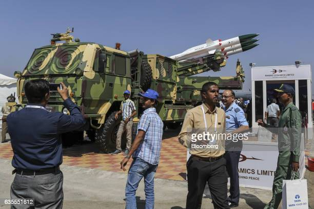Attendees stand in front of a Bharat Dynamics Ltd Akash Weapon System manufactured by the Defense Research and Development Organization on display...