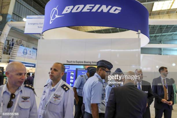 Attendees stand in front of Boeing Co's booth during the Aero India air show at Air Force Station Yelahanka in Bengaluru India on Wednesday Feb 15...