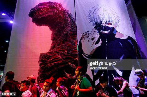 Attendees stand in line for promotional giveaways during Comic Con International on July 20 2017 in San Diego California Comic Con International is...