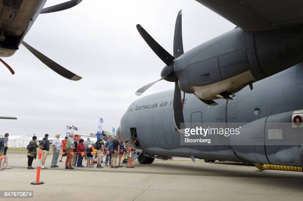 Attendees stand in line to board an Australian Defence Force C130J Super Hercules turboprop military transport aircraft manufactured by Lockheed...