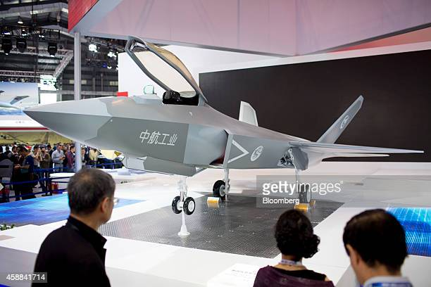 Attendees stand near an Aviation Industry Corp of China FC31 fourthgeneration jet during the China International Aviation Aerospace Exhibition in...