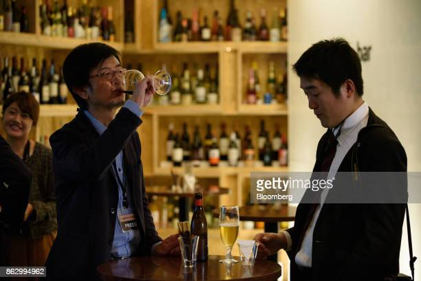 Attendees stand with drinks at the Amazon Bar operated by Amazon Japan KK during a media preview in Tokyo Japan on Thursday Oct 19 2017 For 10 days...
