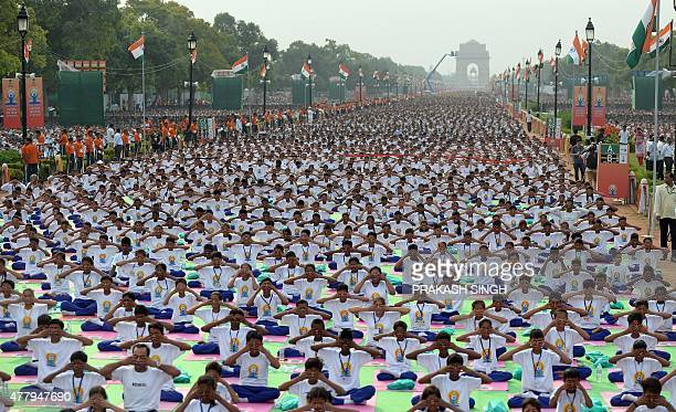 Attendees take part in a mass yoga session to mark the International Yoga Day on Rajpath in New Delhi on June 21 2015 Prime Minister Narendra Modi on...
