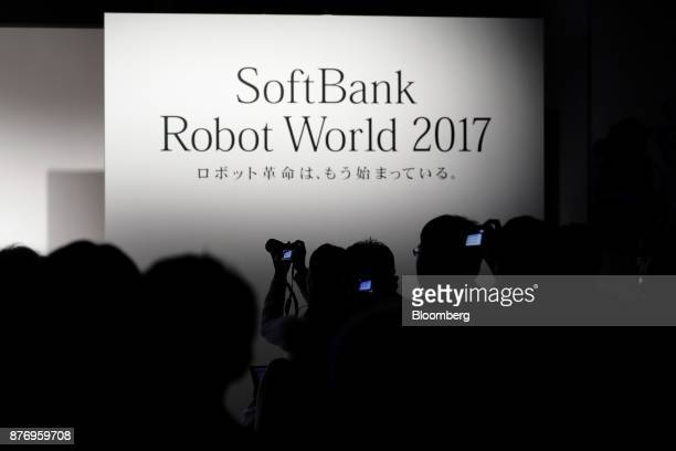 Attendees take photographs during a talk session at the SoftBank Robot World 2017 in Tokyo Japan on Tuesday Nov 21 2017 SoftBank Chief Executive...