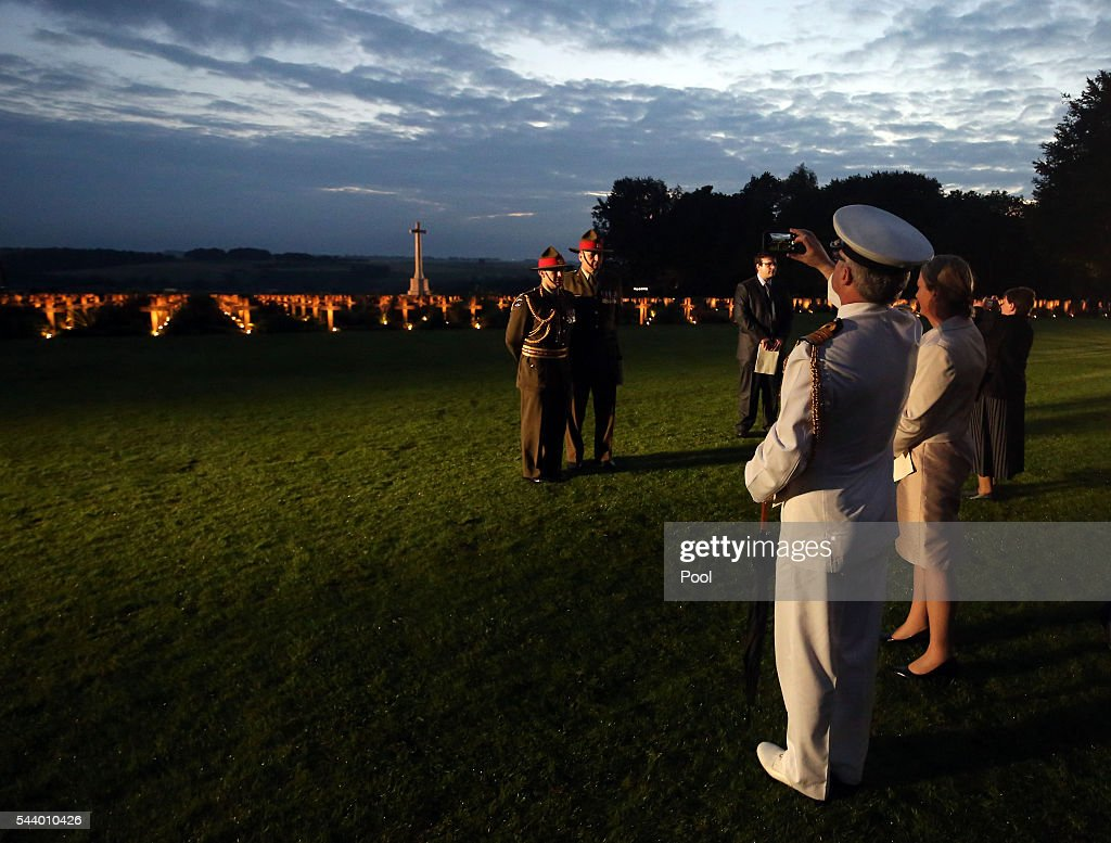 Attendees takes photographs after a military-led vigil to commemorate the 100th anniversary of the beginning of the Battle of the Somme at the Thiepval memorial to the Missing on June 30, 2016 in Thiepval, France. The event is part of the Commemoration of the Centenary of the Battle of the Somme at the Commonwealth War Graves Commission Thiepval Memorial in Thiepval, France, where 70,000 British and Commonwealth soldiers with no known grave are commemorated.