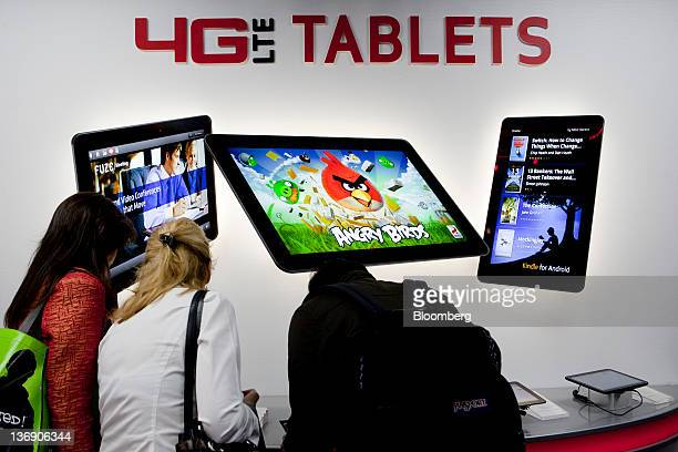 Attendees test out 4G LTE tablets at the Verizon Communications Inc booth at the International Consumer Electronics Show in Las Vegas Nevada US on...