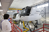 Attendees tour flight simulators at the American Airlines Inc Flight Training Center during a recruiting event in Fort Worth Texas US on Wednesday...