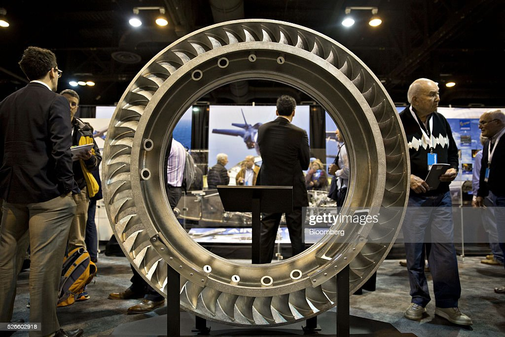 Attendees tour the Precision Castparts Corp. booth during the Berkshire Hathaway Inc. annual shareholders meeting in Omaha, Nebraska, U.S., on Saturday, April 30, 2016. Dozens of Berkshire Hathaway Inc. subsidiaries will be showing off their products as Chief Executive Officer Warren Buffett hosts the company's annual meeting. Photographer: Daniel Acker/Bloomberg via Getty Images